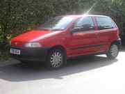 Red 3 door Fiat punto